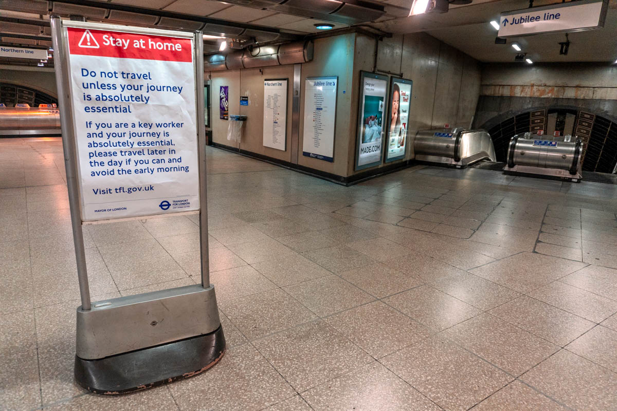 A sign at London Bridge tube station advises people not to travel unless absolutely necessary