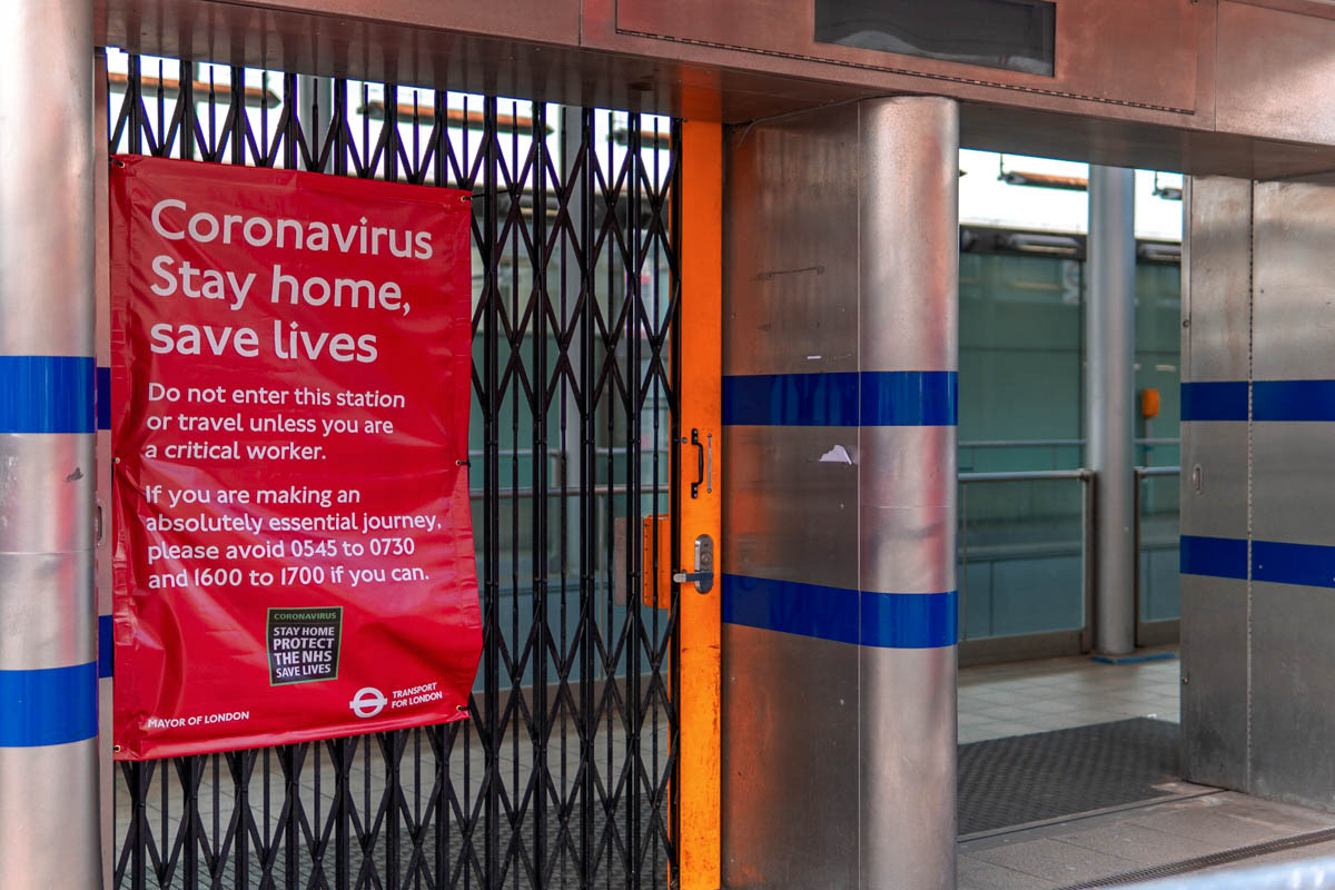 A sign at a tube station during the London coronavirus lockdown advises people not to use public transport unless absolutely necessary